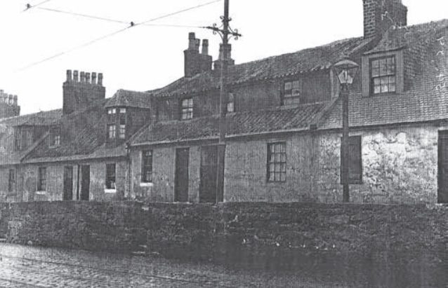 The weavers' cottages at Shinty Ha' photographed in the early 1900s.