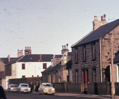 1970s view of Union Road looking north and showing Orchard Cottage with the whitewashed former Sharp's Engineering Works beyond.