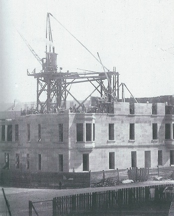 The tenement at 85 Cromwell Street under construction in 1896.
