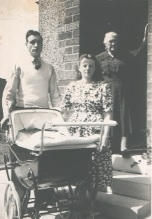 Proud new parents at the front door of 343 Main Street, Rutherglen (1949).